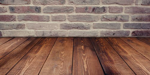 Brown Wooden Panel Beside Concrete Board