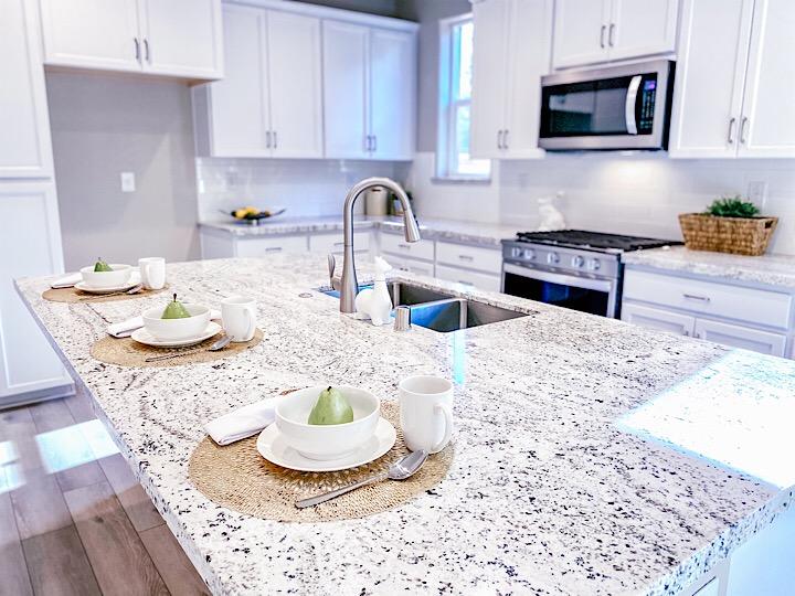 granite counter top in bright white kitchen
