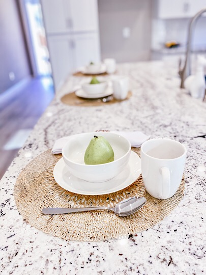 close up of pears on plates on granite countertop. Homes by Towne, Grass Valley