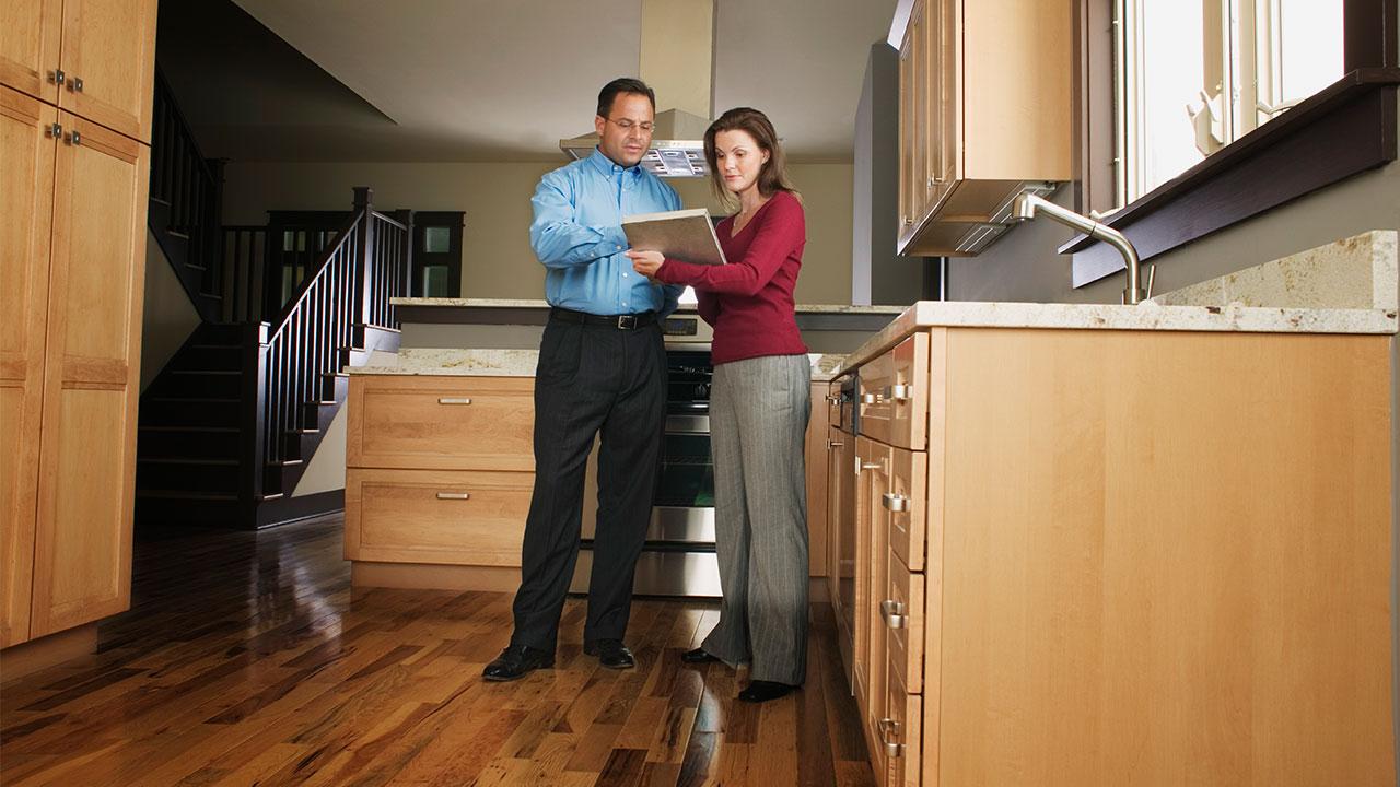 Relator with prospective home buyer
