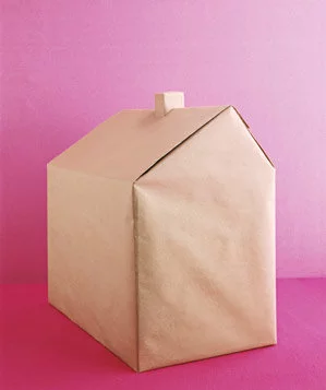 A house wrapped in brown paper
